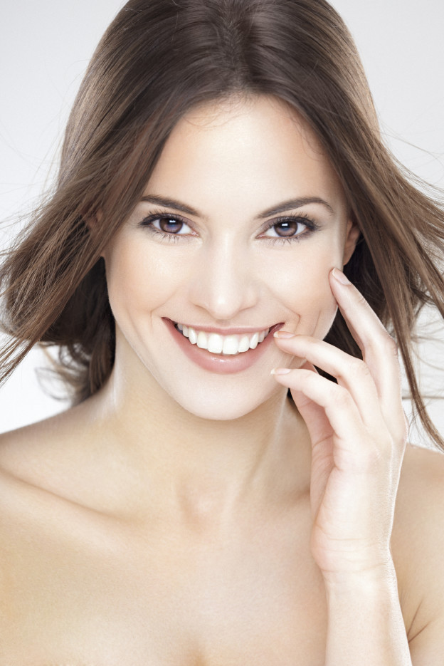 Beauty portrait of a young brunette woman with beautiful smile